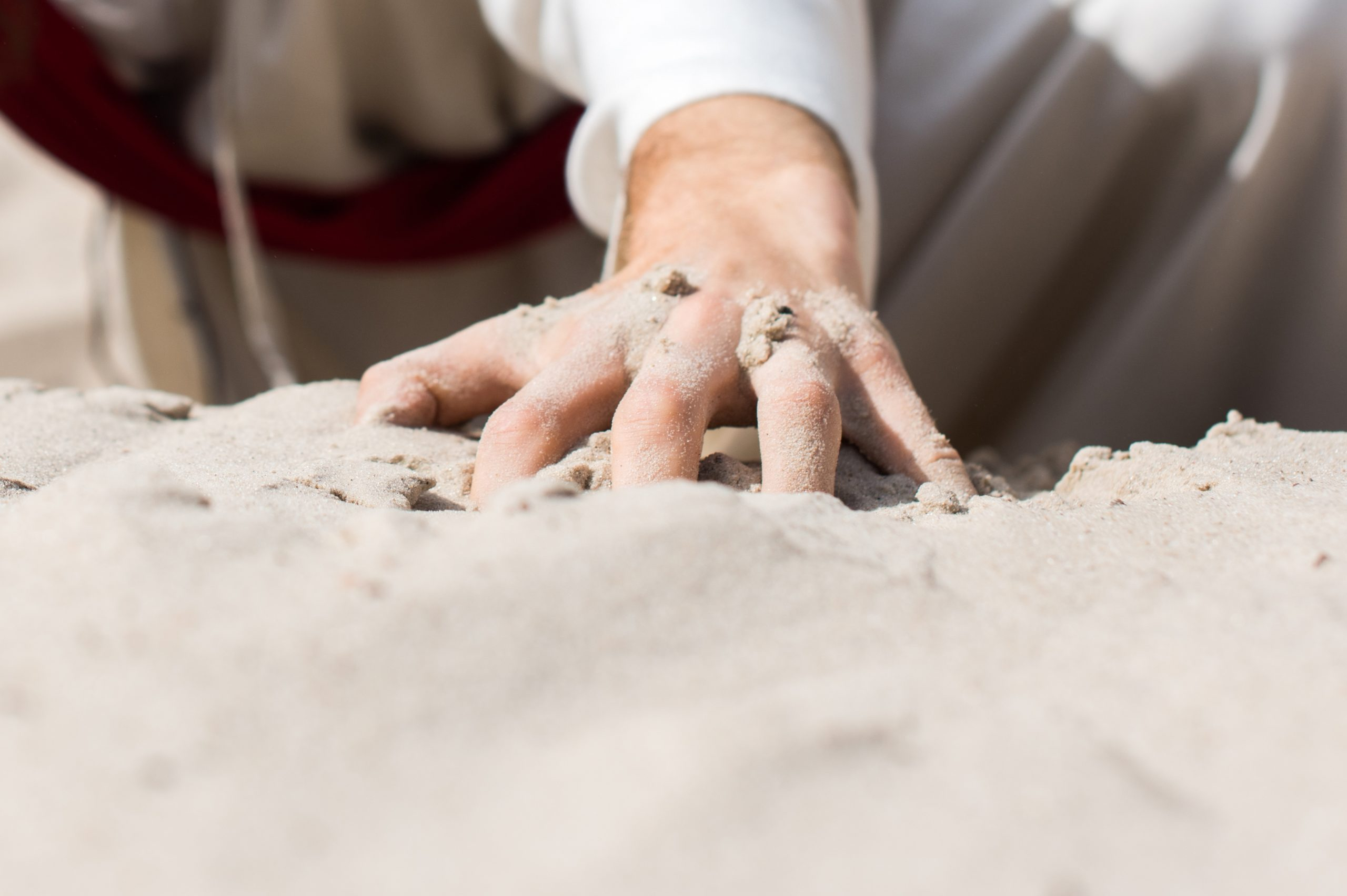 Why did Jesus write in the sand?